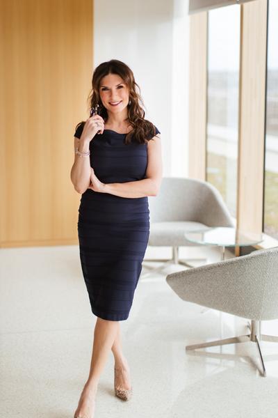 Masha Trainor standing in office