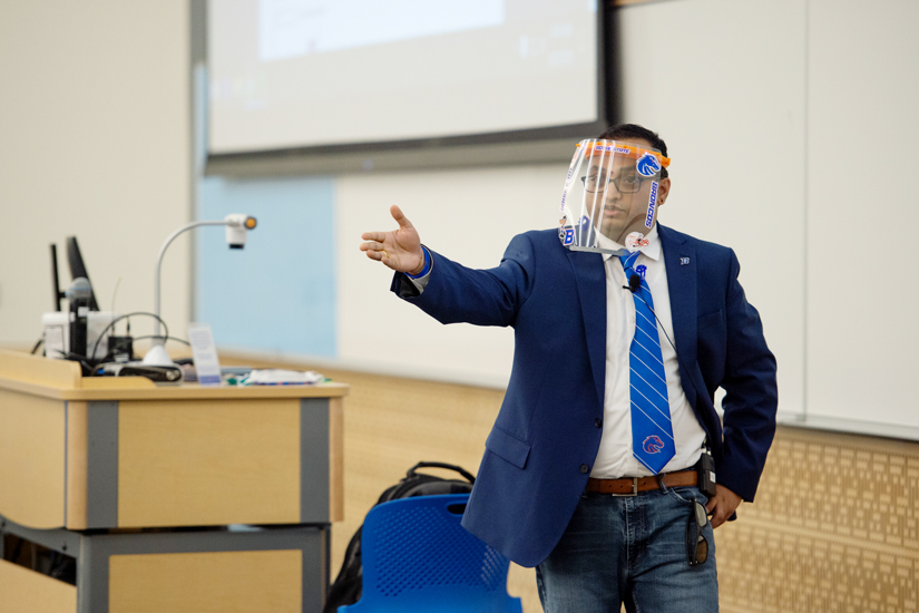 Krishna Pakala at the front of the lecture hall wearing a face shield