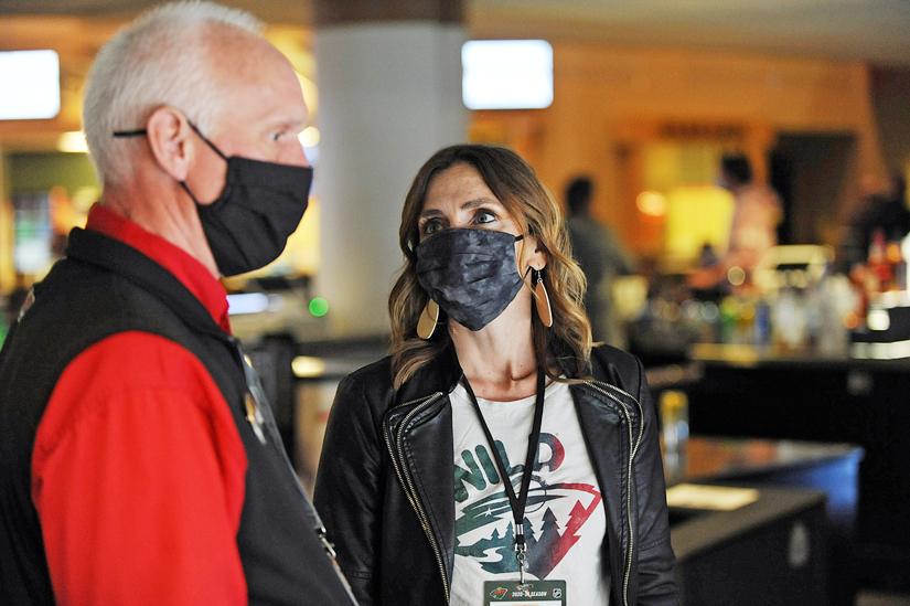 Leah Pitzenberger and long-time Minnesota Wild usher, both wearing masks
