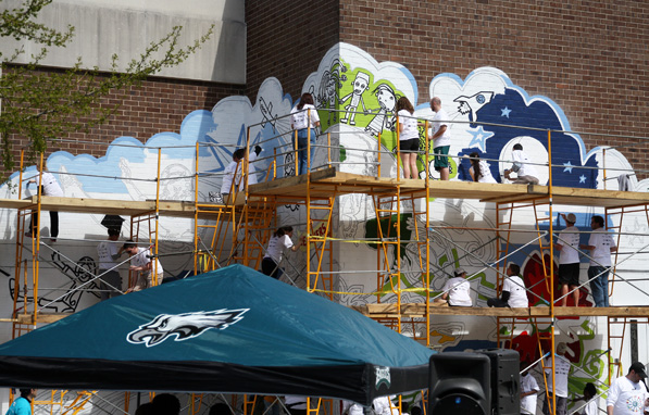 The Philadelphia Eagles' annual playground build is a day of community service where the entire organization joins together to revitalize a school.