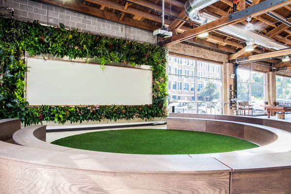 Every February, employees gather in the Field of Dreams to watch the Superbowl. In the offseason, it is used frequently for training, presentations, parties, or just stretching out on a yoga ball.