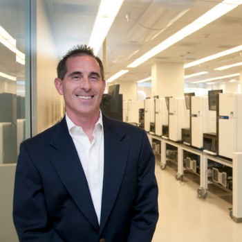 Kirk Malloy, Illumina's Senior VP and General Manager of the life sciences business unit, stands in a lab that sequences thousands of human genomes each year for research and to diagnose complex diseases.