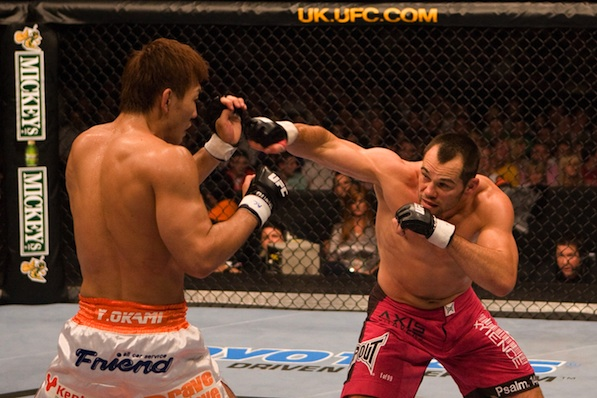 Rich Franklin (right) fights Yushin Okami in UFC 72 at Odyssey Arena in Belfast, Northern Island, on June 16, 2007. Behind the scenes, Christy King and her team made rapid adjustments to the broadcast system, renting out an Internet café in order to hit sufficient upload speeds. Franklin would go on to defeat Okami, and King won her fight as well, getting all footage completely uploaded for broadcast early the next morning.