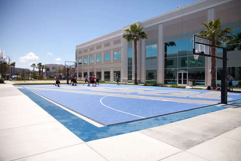 ViaSat's campus is designed to meet the needs of its staff. Employees can bike between buildings and enjoy a basketball or volleyball game during lunch.