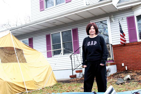 "Carole Ball, a nurse case manager at Monmouth Medical Center, recalls her entire neighborhood looking like a war zone after Hurricane Sandy. ""The Tuesday after the storm, we were rescued from our home around 4 a.m.,"" says Ball, who lost three cars and a motorcycle. ""That morning was the first time in 40 years that I was a no call, no show to work."""
